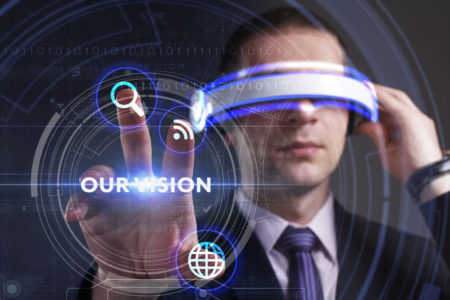72429720 - business, technology, internet and network concept. young businessman working in virtual reality glasses sees the inscription: our vision